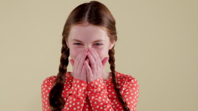 mcs young girl making facial expressions  - hands covering mouth stock videos and b-roll footage