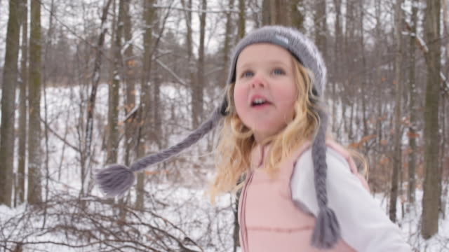 young girl on a snow covered trail - mitten stock videos and b-roll footage