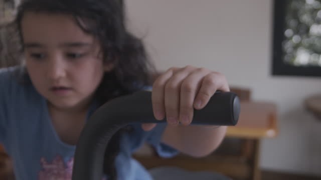 young girl on exercise bike in room - exercise bike stock videos & royalty-free footage