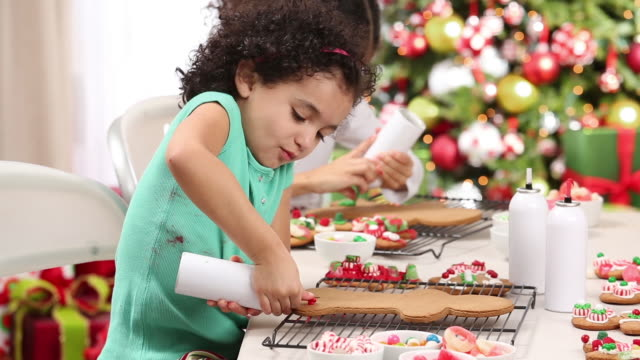 young girl opening christmas present - ornato video stock e b–roll