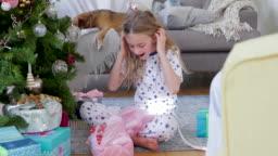 Young Girl Opening Christmas Presents on Christmas
