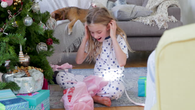 Young Girl Opening Christmas Presents on Christmas