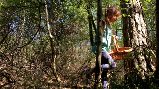Young Girl Picking Wild Asparagus