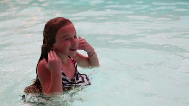 ms young girl playing in pool / lamy, new mexico, united states - lamy new mexico stock videos and b-roll footage