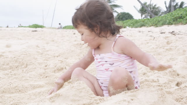 ms, a young girl playing in the sand on a beach - nur kinder stock-videos und b-roll-filmmaterial