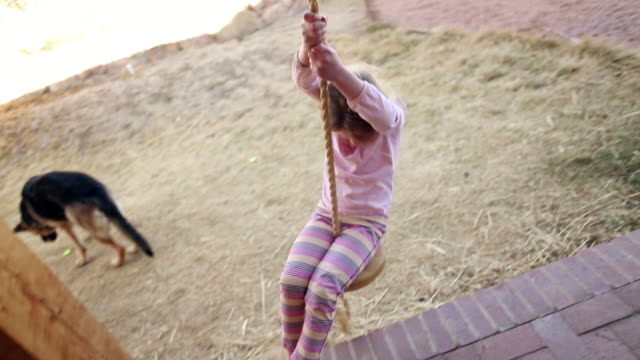 MS TS Young girl playing on rope swing / Lamy, New Mexico, United States