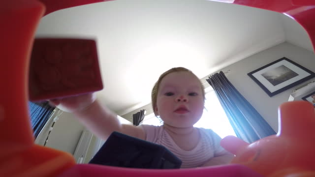 a young girl playing with a box of toys inside of a home. - babies only stock videos & royalty-free footage