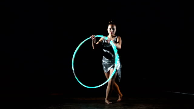 young girl playing with hula hoop. - artista video stock e b–roll