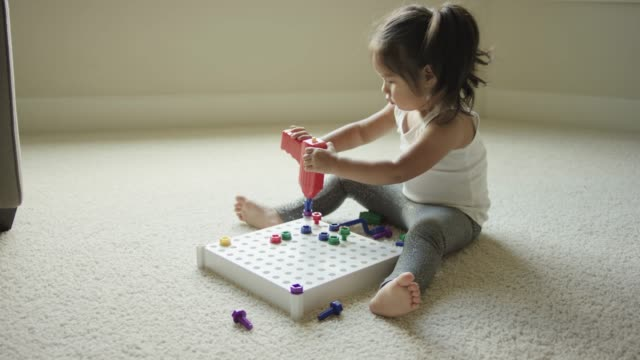Young girl playing with STEM toys