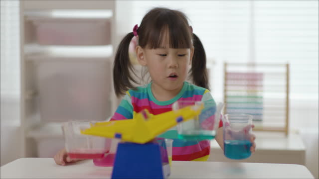 young girl plays balance toy for home schooling - balance stock videos & royalty-free footage