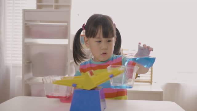young girl plays balance toy for home schooling - only girls stock videos & royalty-free footage