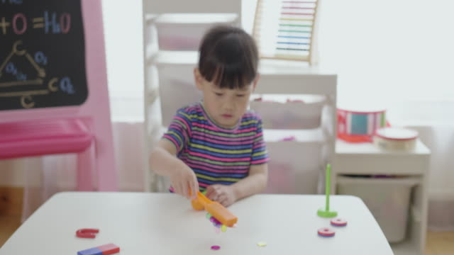 young girl plays magical magnet experiments for home schooling - magnet stock videos & royalty-free footage