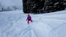 Young girl powder skiing