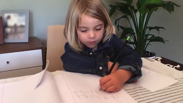 young girl practices her handwriting at home during her virtual school session - primary school child stock videos & royalty-free footage