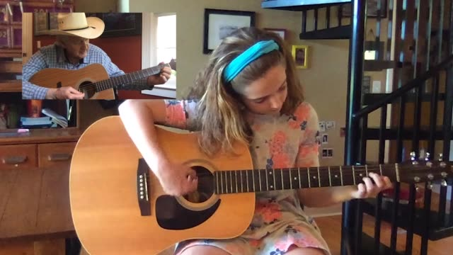 young girl practices playing acoustic guitar with her grandfather via video call (audio) - only girls stock videos & royalty-free footage