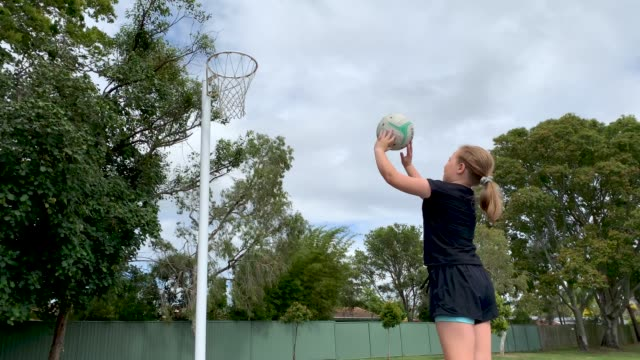 young girl practicing netball - hitting stock videos & royalty-free footage