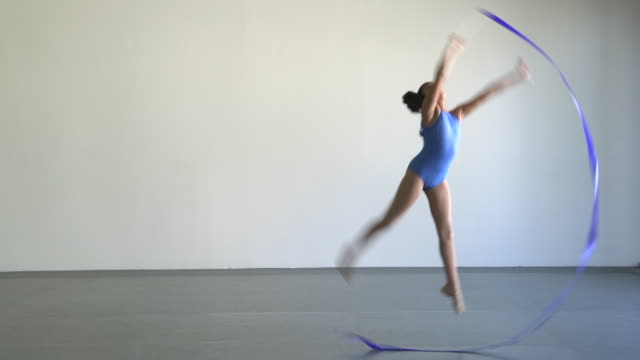 SM WS Young girl practicing with a ribbon in dance studio