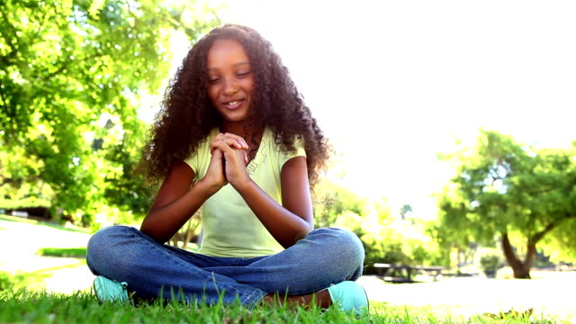 young girl praying in the park - mormonism stock videos & royalty-free footage
