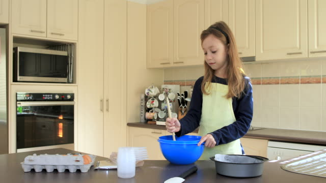 young girl preparing icing for chocolate cake - one girl only stock videos & royalty-free footage