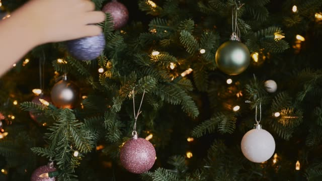 young girl putting decorations on christmas tree - imitation stock videos & royalty-free footage