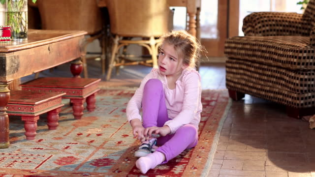 ms young girl putting on her shoes / lamy, new mexico, united states - socke stock-videos und b-roll-filmmaterial