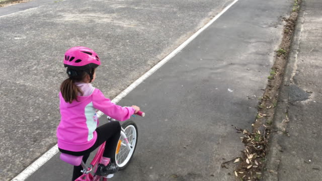 young girl rides a bike - cycling helmet stock videos & royalty-free footage