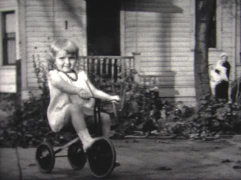 1934 young girl rides on tricycle - tricycle stock videos and b-roll footage