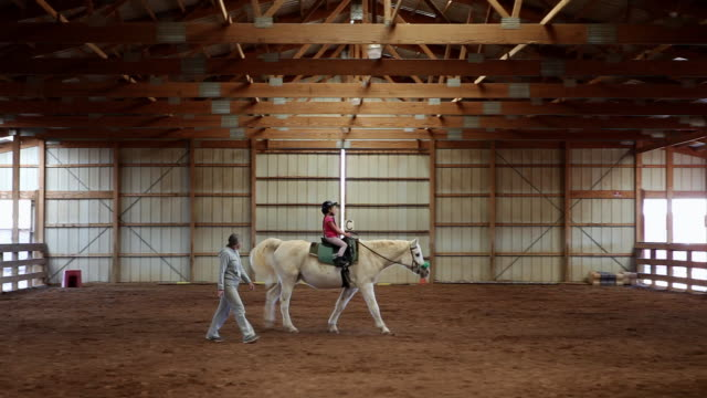 ms young girl riding horse with her instructor / lamy, new mexico, united states - lamy new mexico stock videos and b-roll footage