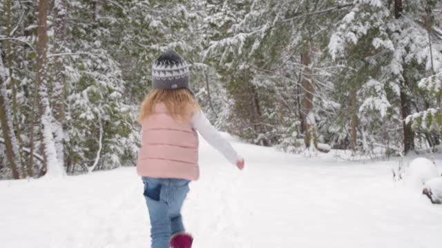 young girl running down snow covered trail - mitten stock videos and b-roll footage