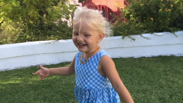 young girl running round camera by pool - mid length hair stock videos & royalty-free footage