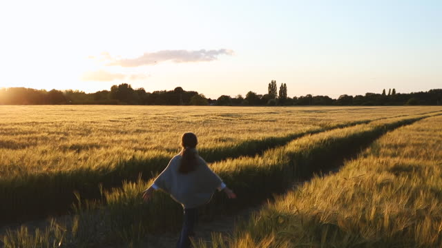 young girl running through field - long stock videos & royalty-free footage