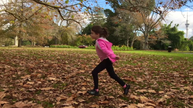 Young girl runs in slow motion in the park