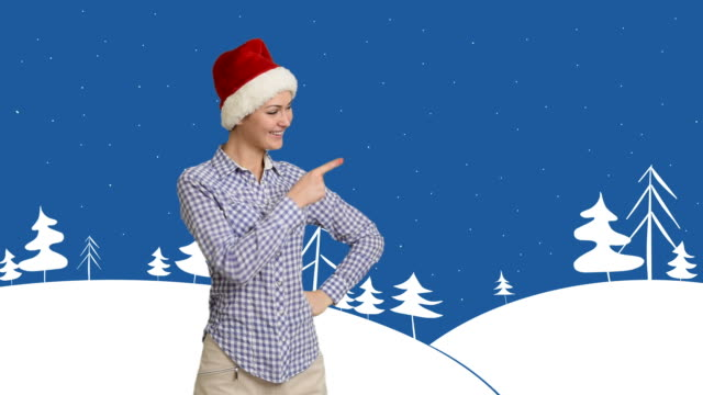 young girl shows copy space in shirt and santa hat on a cartoon background on the theme of winter - red dress stock videos & royalty-free footage