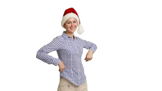 young girl shows copy space in shirt and santa hat on a white screen - santa hat stock videos and b-roll footage