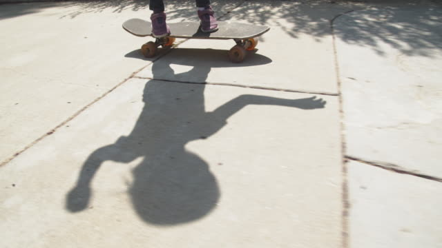 sm young girl skateboarding on her driveway - driveway stock videos & royalty-free footage