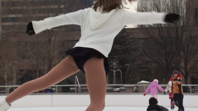 a young girl skating at a busy rink - see other clips from this shoot 1145 stock videos & royalty-free footage