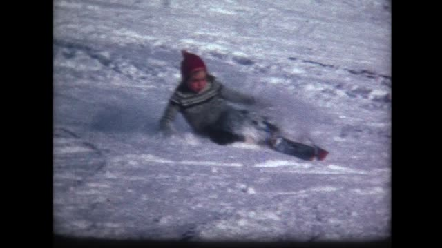 1966 young girl skier wipes out a few times
