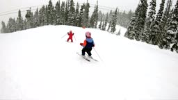 Young girl skiing down the slope