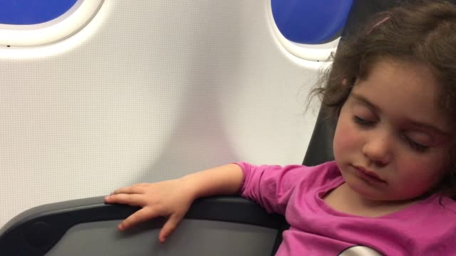 Young Girl Sleeping in Airplane