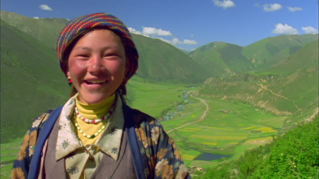 Young girl smiles and laughs at camera, Tibet Available in HD.