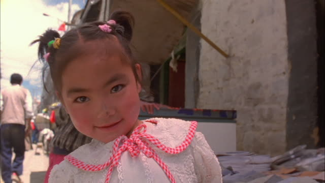 young girl smiles at camera available in hd. - tibet stock videos & royalty-free footage