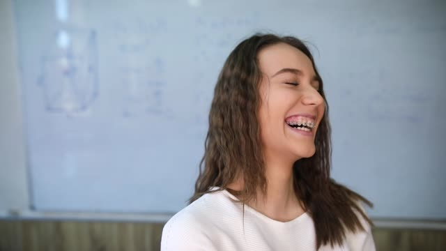 young girl smiling in school - 18 19 years stock videos & royalty-free footage