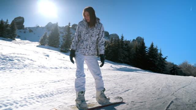 Junges Mädchen, Snowboarden