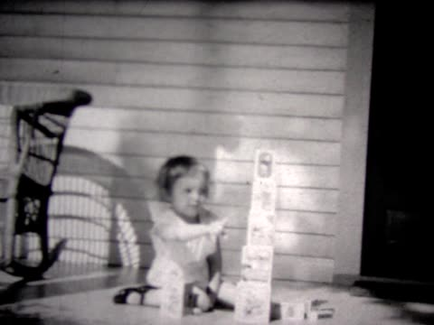 1935 young girl stacking blocks gets upset