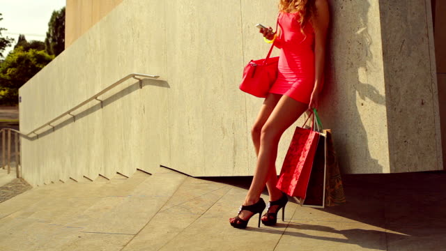 young girl standing by the wall. shopping - skirt stock videos & royalty-free footage