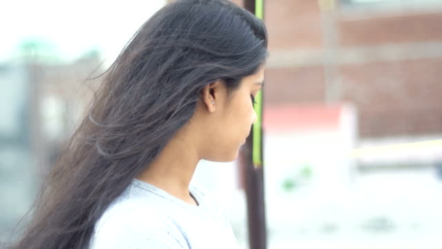 young girl standing in balcony with blank expressions and looking away - standing stock videos & royalty-free footage