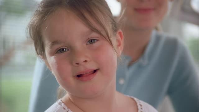 vídeos de stock e filmes b-roll de a young girl sticks out her tongue. - língua humana