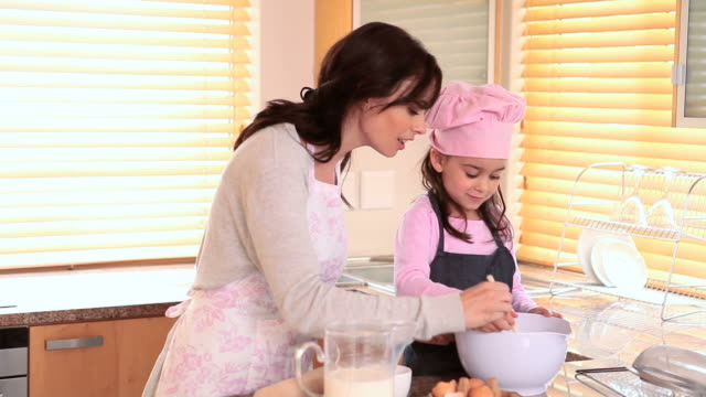 young girl stirring something - chef's hat stock videos & royalty-free footage