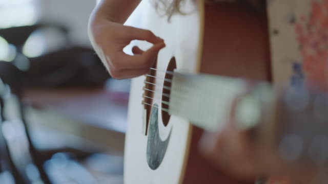 cu of young girl strumming an acoustic guitar - human finger stock videos & royalty-free footage