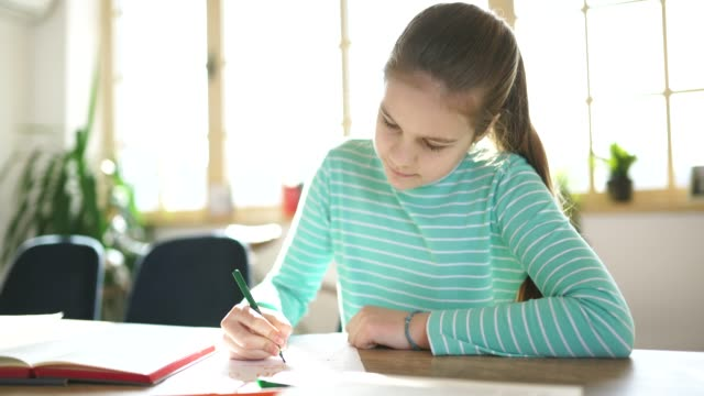 young girl student studying alone - homework stock videos & royalty-free footage
